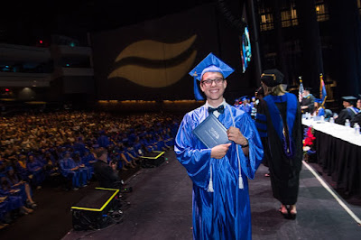 Photos of young grad smiling at camera, on graduation stage with his diploma.