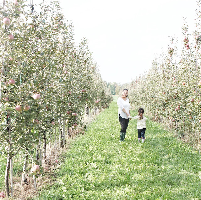 mom and daughter in apple orchid