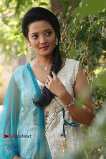 Tamil Actress Koushika Stills in White Salwar Kameez at Inayathalam Tamil Movie Audio Launch  0008.jpg