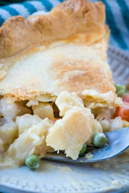 fork scooping up a bite of creamy chicken pot pie
