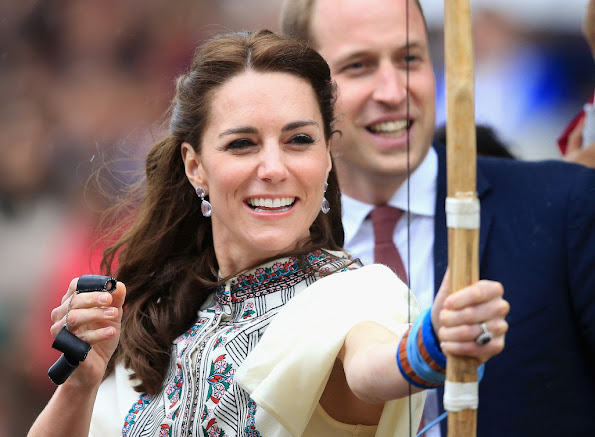 Prince William and Duchess Catherine of Cambridge tried to make a shot with the traditional bow during their Bhutan visit.