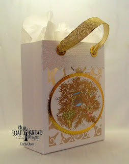 Our Daily Bread Designs, Card Caddy and Gift Bag Die,  Double Stitched Oval dies,  Oval Stitched Rows Dies, Poinsettia Inset Dies,  Gift Bag Handles and Toppers Die and Noel Ornaments stamp set.