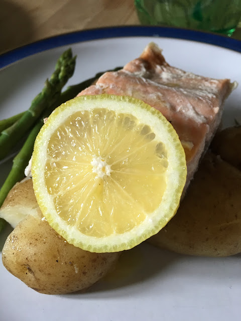 poached salmon with crushed new potatoes, asparagus and lemon butter