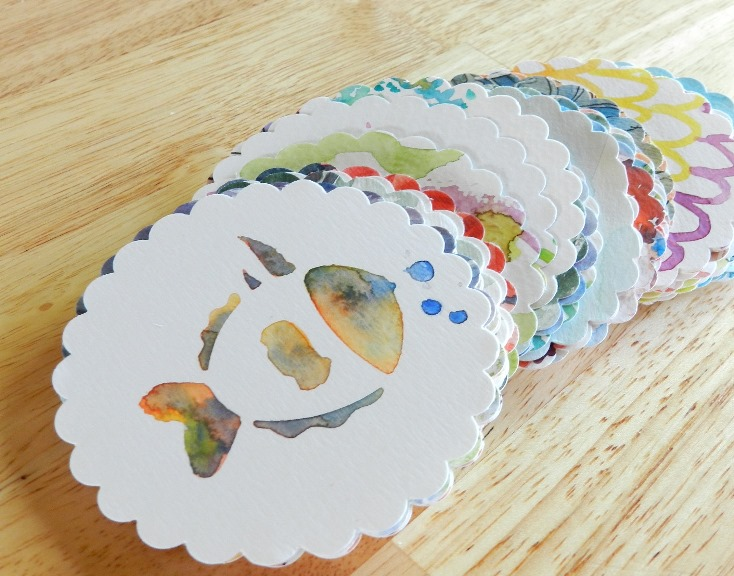 Recycle old watercolor paintings in paper flower cut-outs