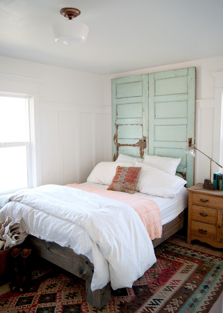 Farmhouse Master Bedroom Reveal - Benjamin Moore Simply White, antique wash stand, glass shade pharmacy lamp, crosby lamp, target , door headboard, kilim rug
