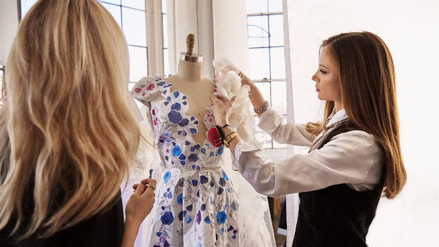 Georgina Chapman and Keren Craig - Marchesa Founders with the dress