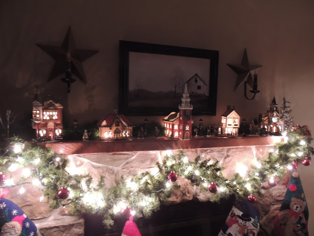 The mantel looks amazing with the Department 56 Village Display from Walking on Sunshine Recipes.