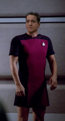 Chakotay wearing TNG skant uniform