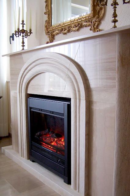 revestimiento de chimenea en piedra y mármol serpeggiante