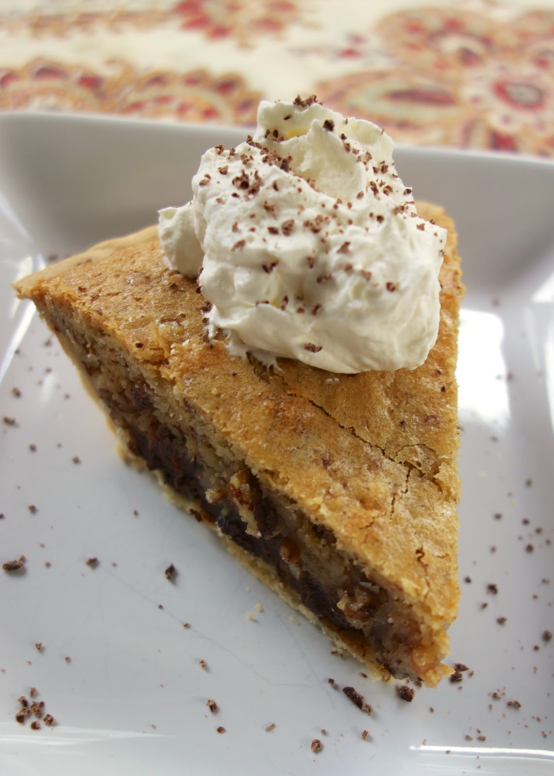 Kentucky Derby Pie with Bourbon Whipped Cream - pie crust filled with butter, sugar, eggs, vanilla, flour, pecans and chocolate chips. Top with some quick homemade bourbon whipped cream. This is ridiculously good! Everyone raves about it!!