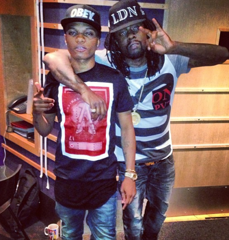wizkid throws his drink at a man london