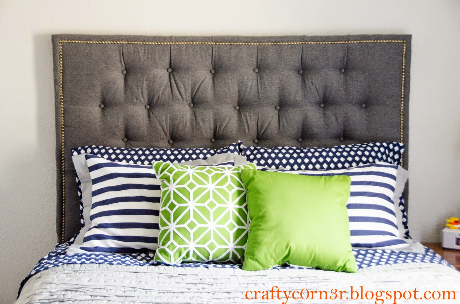 http://craftyc0rn3r.blogspot.com/2014/06/nailhead-trimmed-and-tufted-headboard.html
