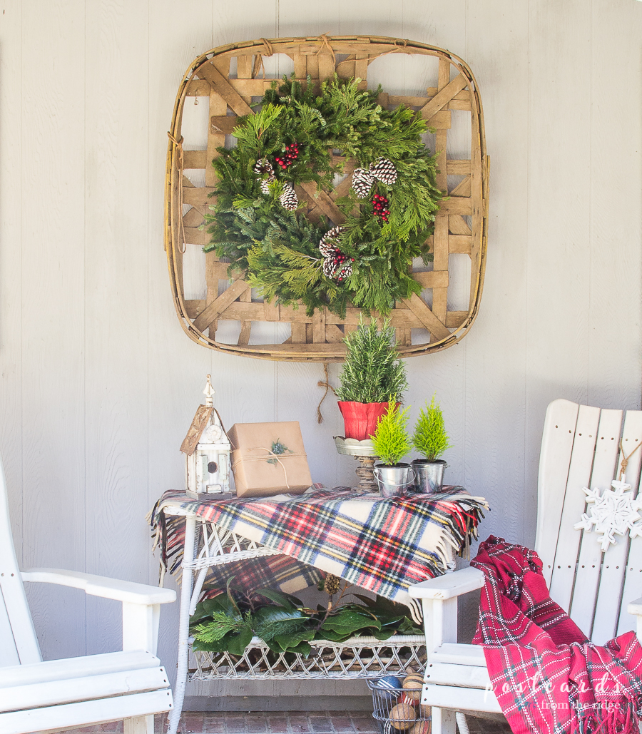 white adirondack chairs and Christmas decor on a porch