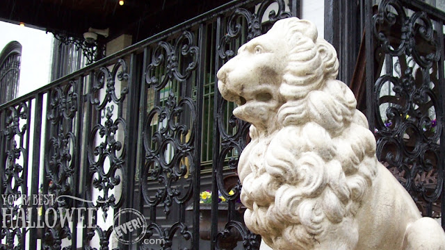 lion statue by the porch of the Lemp Mansion in St. Louis, MO