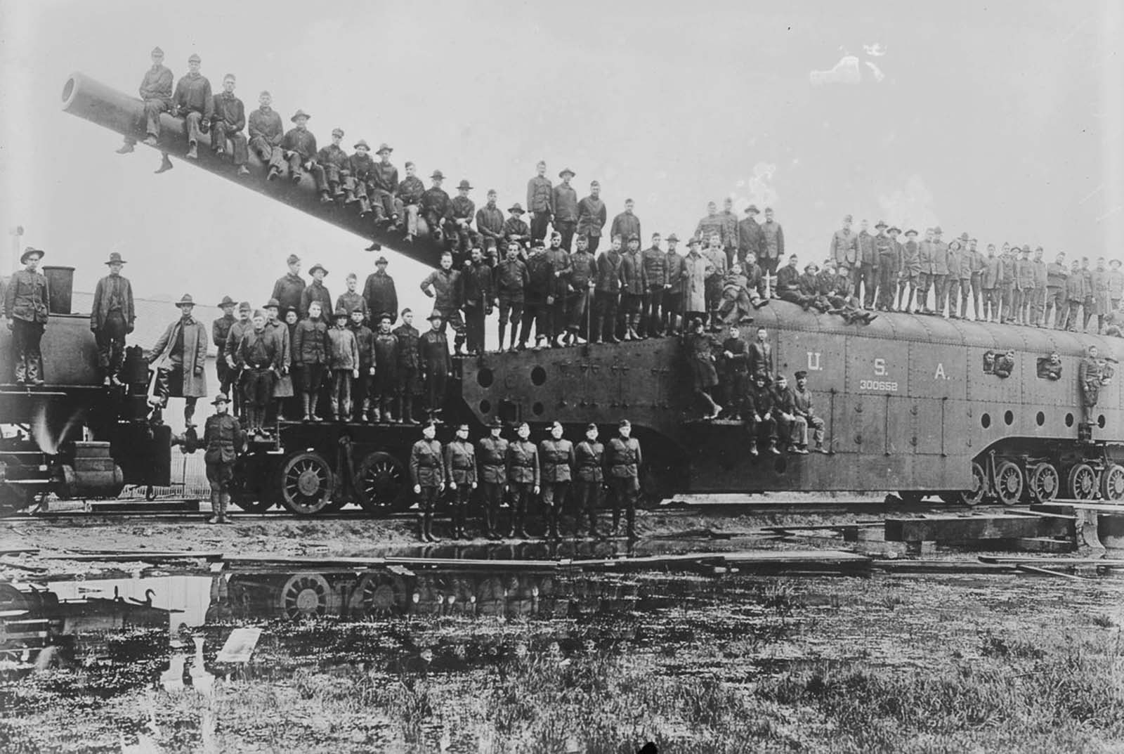 An artillery unit poses on a massive railway gun in France. 1918.