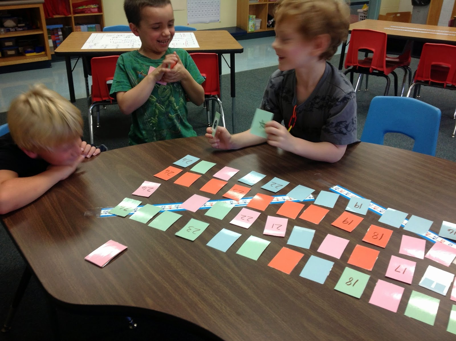 another helping of math please treasure hunt if the card you pick up is a number then you pass it to the next person and they figure out where the number goes in the sequence and which color row