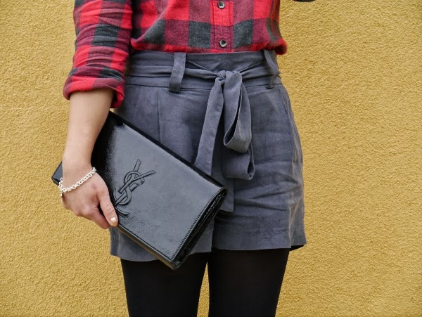 Vancouver blogger Lisa Wong of Solo Lisa wears a J. Crew buffalo plaid shirt, CiCi grey tie-waist shorts, a silver Maison Birks charm bracelet, and a Saint Laurent 'Belle de Jour' clutch in black patent.
