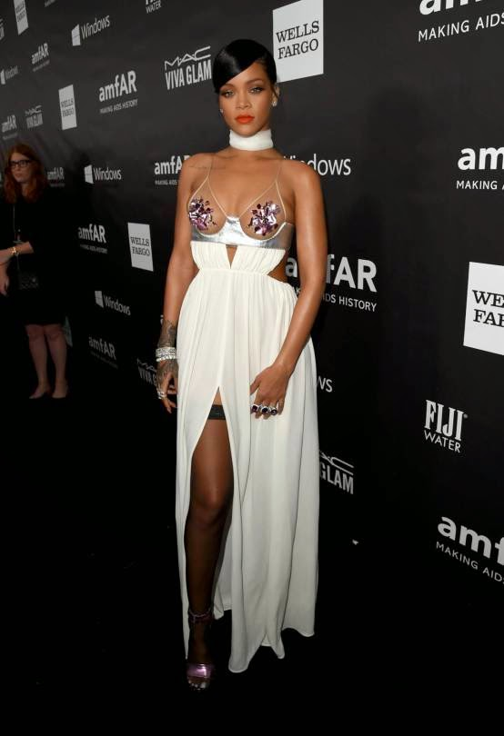 Rihanna wears a revealing Tom Ford gown to the 2014 amfAR LA Inspiration Gala