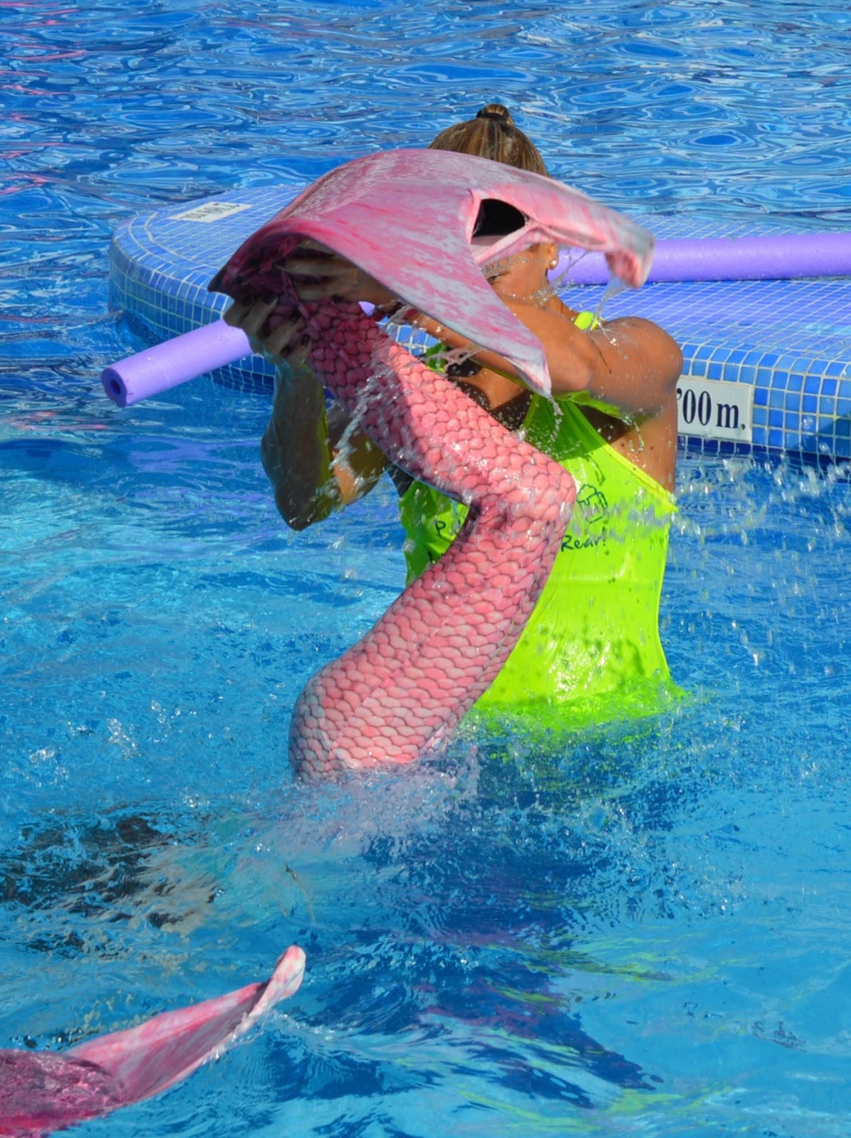 Pirate Swimming Pools and Mermaid Lessons at Pirates Village, Majorca - mermaid tail wave