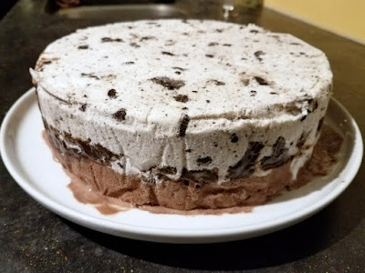 ice cream cake out of pan ready for whipped cream frosting