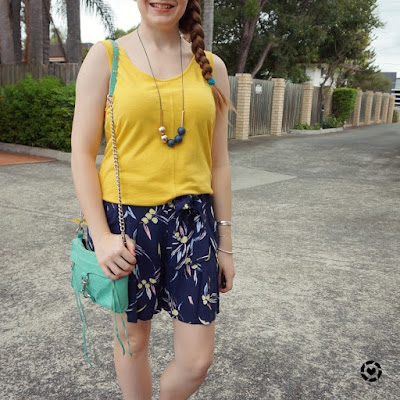 awayfromblue Instagram | mustard tank with pastel navy print culotte shorts and mint mini mac bag summer style