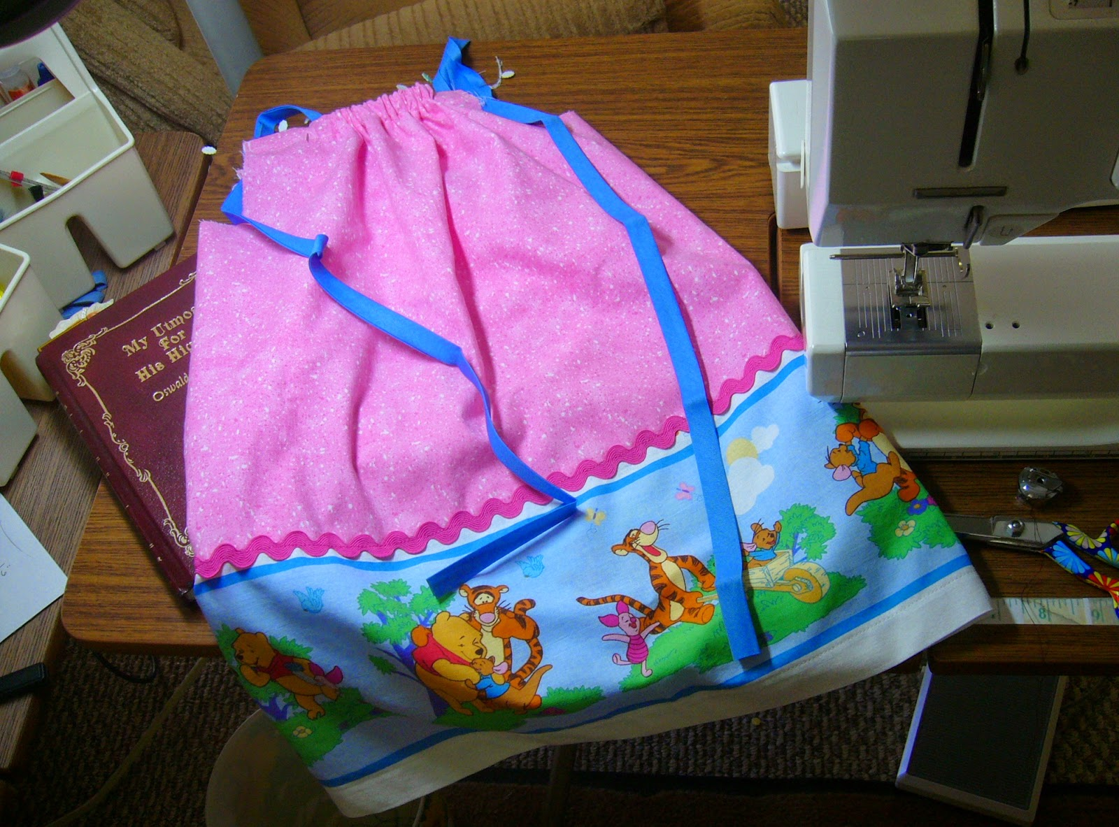 Winnie the Pooh Dress waiting to be finished for an Operation Christmas Child shoebox.