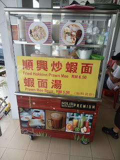 It says Fried Hokkien Prawn Mee and Prawn Mee Soup