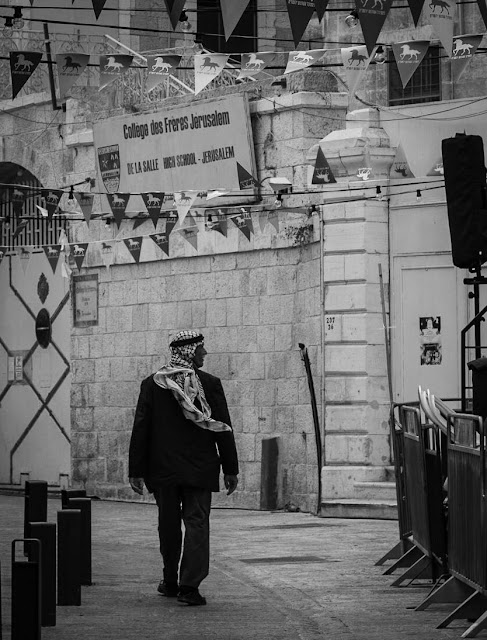 An elder Palestinian man wandering the Christian quarter of the Old City of Jerusalem