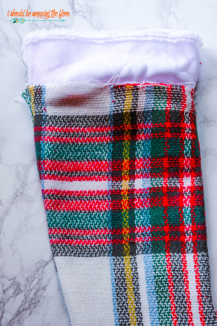 DIY Blanket Scarf Stocking made from an actual blanket scarf (get up to 6 stockings from a single scarf!). Easy-to-follow photo tutorial.