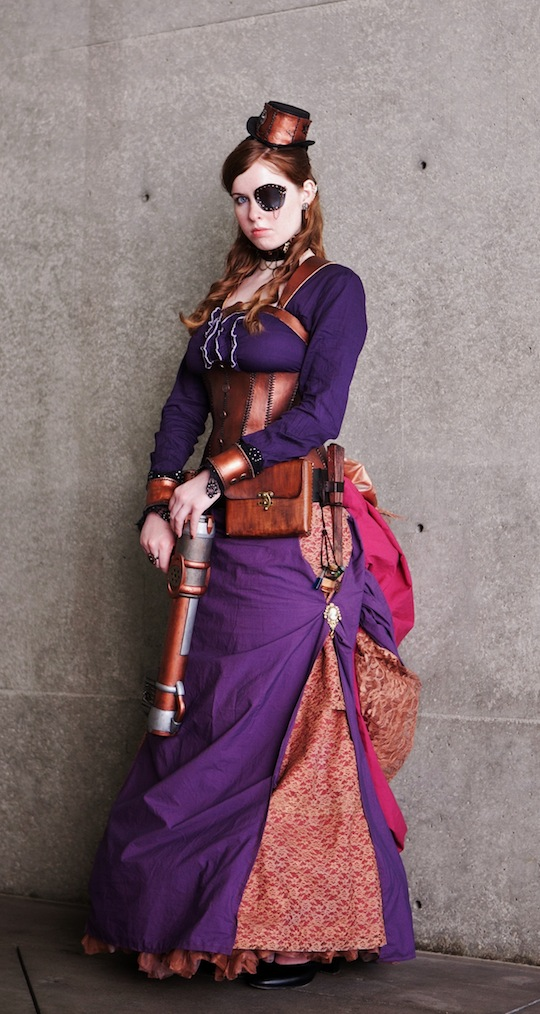 Woman wearing a purple steampunk assassin costume. purple victorian dress, leather corset, leather eyepatch, gun