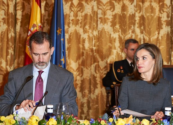 Queen Letizia carries Madmacarena python snake clutch bag. Uterque shoes, diamond jewellery earrings