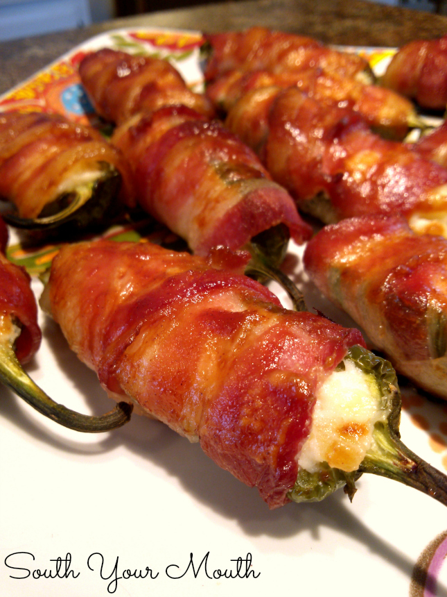 Bacon-Wrapped Pineapple Jalapeno Poppers! An amazing appetizer recipe for jalapeno peppers stuffed with a pineapple cream cheese filling wrapped in bacon then basted with barbeque sauce.
