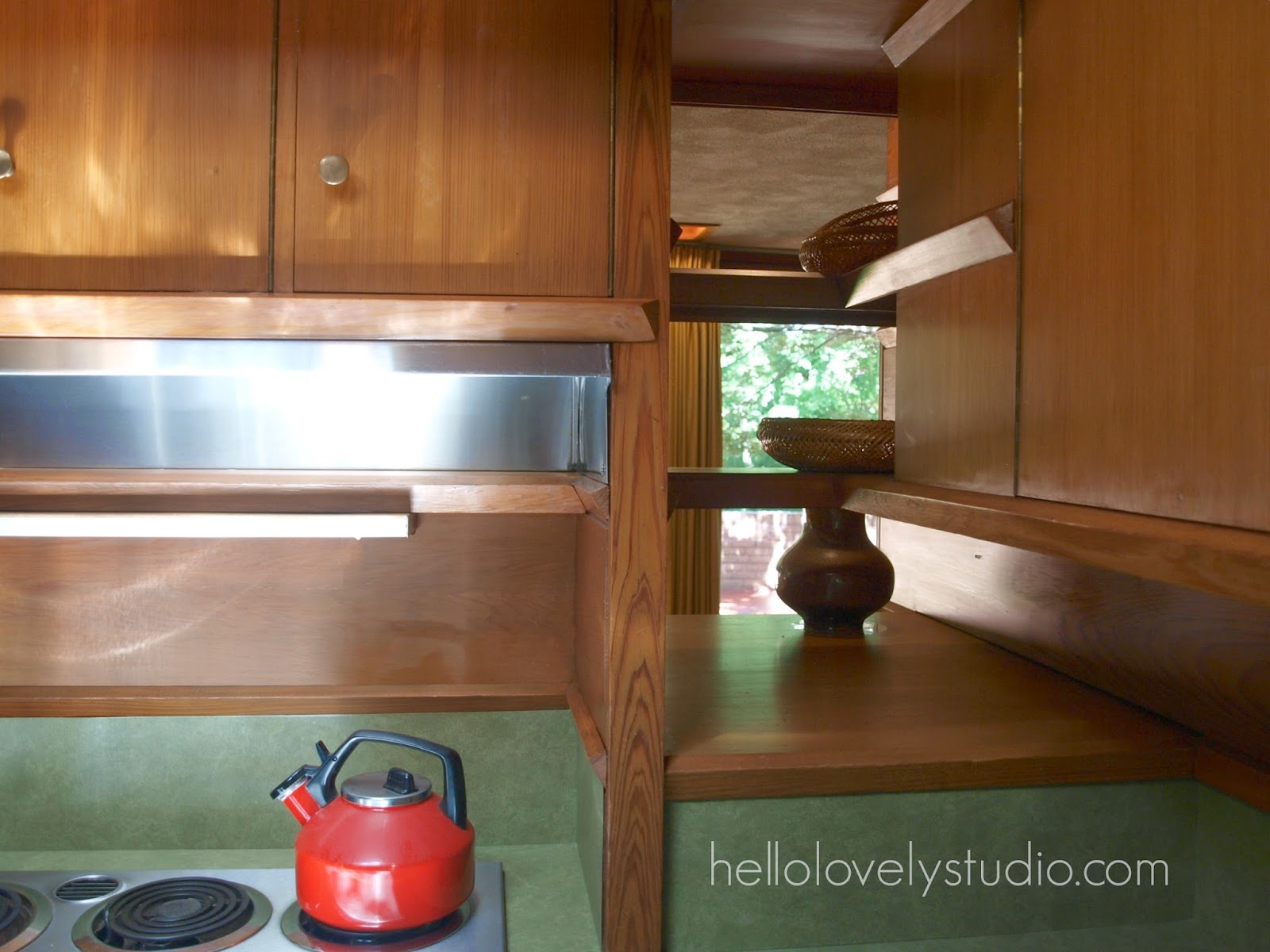 Kitchen with green laminate counter and backsplash. Frank Lloyd Wright Laurent House designed for owner Kenneth Laurent on Spring Brook Road in Rockford/ Designed to be wheelchair-accessible. #flw #franklloydwrighthouse #midcenturymodernarchitecture