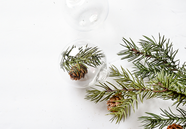 Adding greenery to clear Dollar Tree ornaments