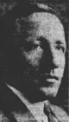 3/4 profile of a middle-aged white man in a jacket and tie