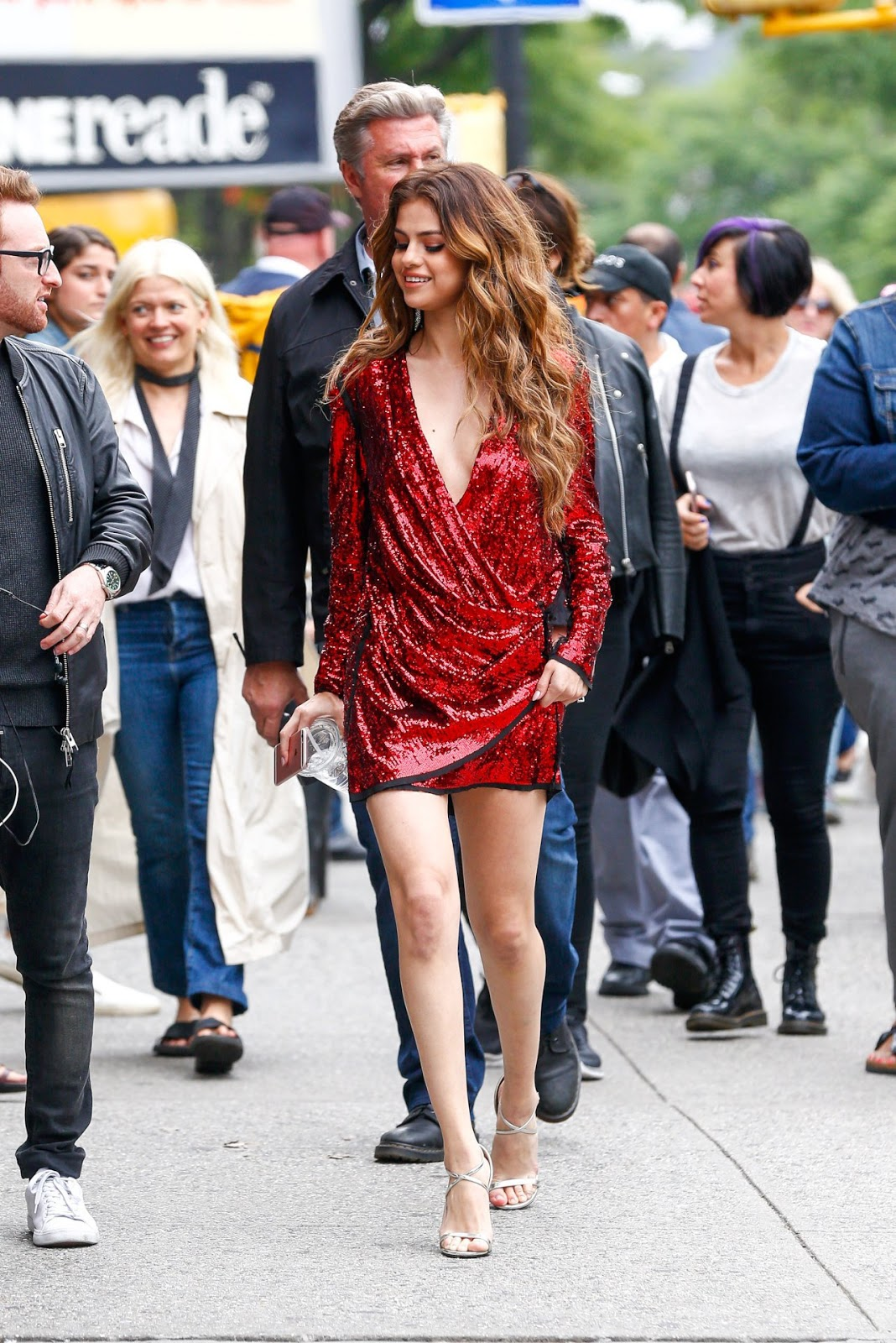 Selena Gomez seen in a plunging dress for photoshoot in NYC