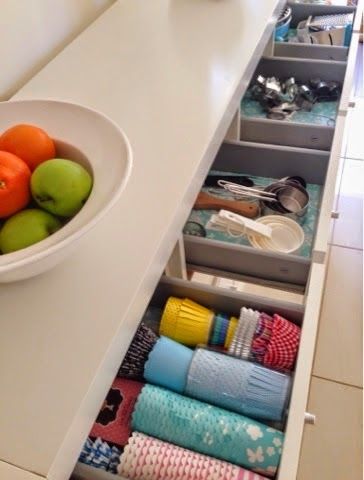 Opened kitchen drawers all organized.