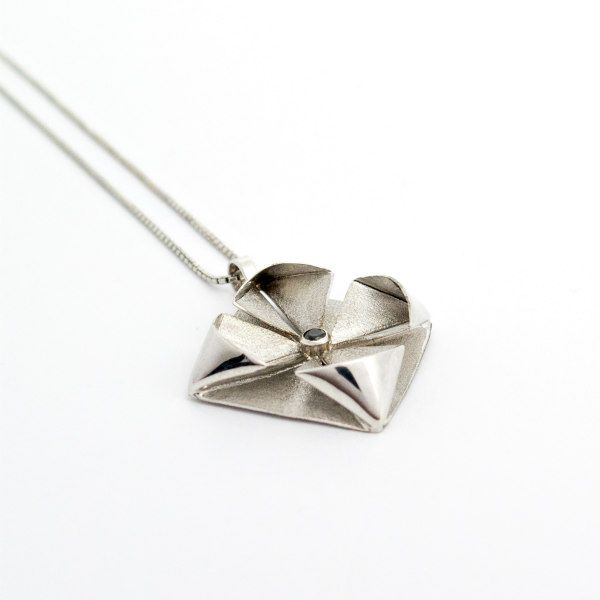 silver metal origami necklace pendant on silver chain