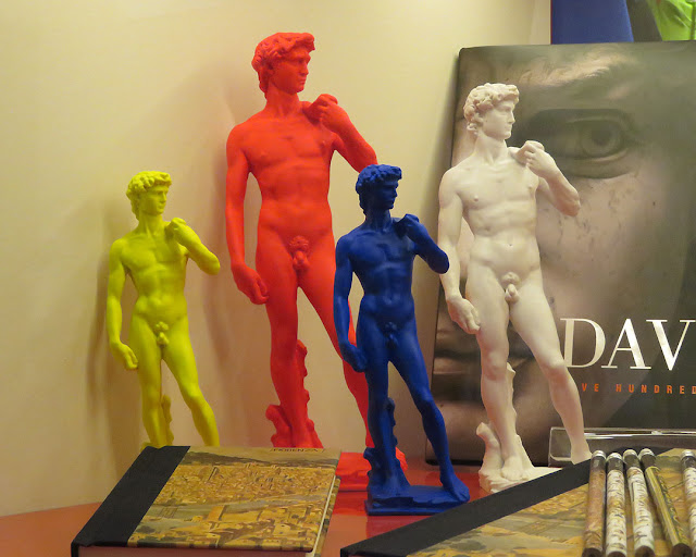Bright colored statuettes of the David by Michelangelo, Johnson & Relatives, Via del  Proconsolo, Florence