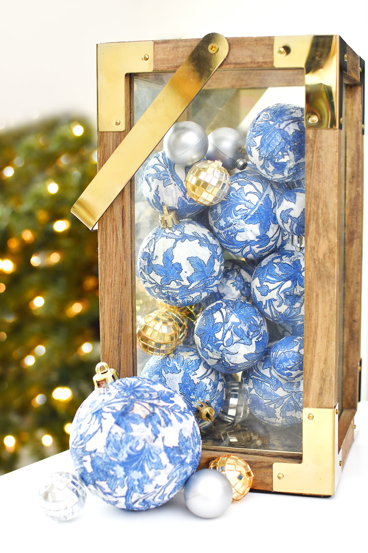 Blue and white chinoiserie ornaments in a farmhouse lantern