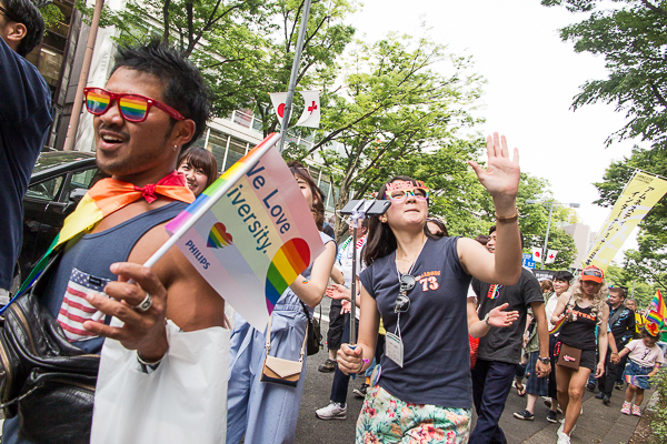 """We love diversity"" - Marchers at Tokyo Rainbow Pride 2016 with flags."
