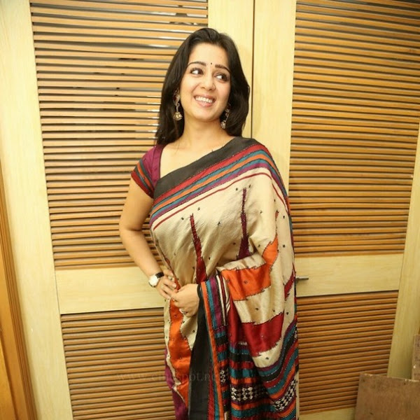 Charmi Kaur latest hot photos in saree from Telugu movie Jyothi Lakshmi First Look Launch