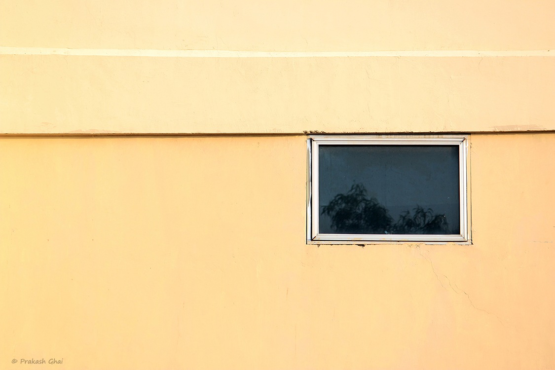 A Minimalist Photo of Two Rectangles on a colored wall
