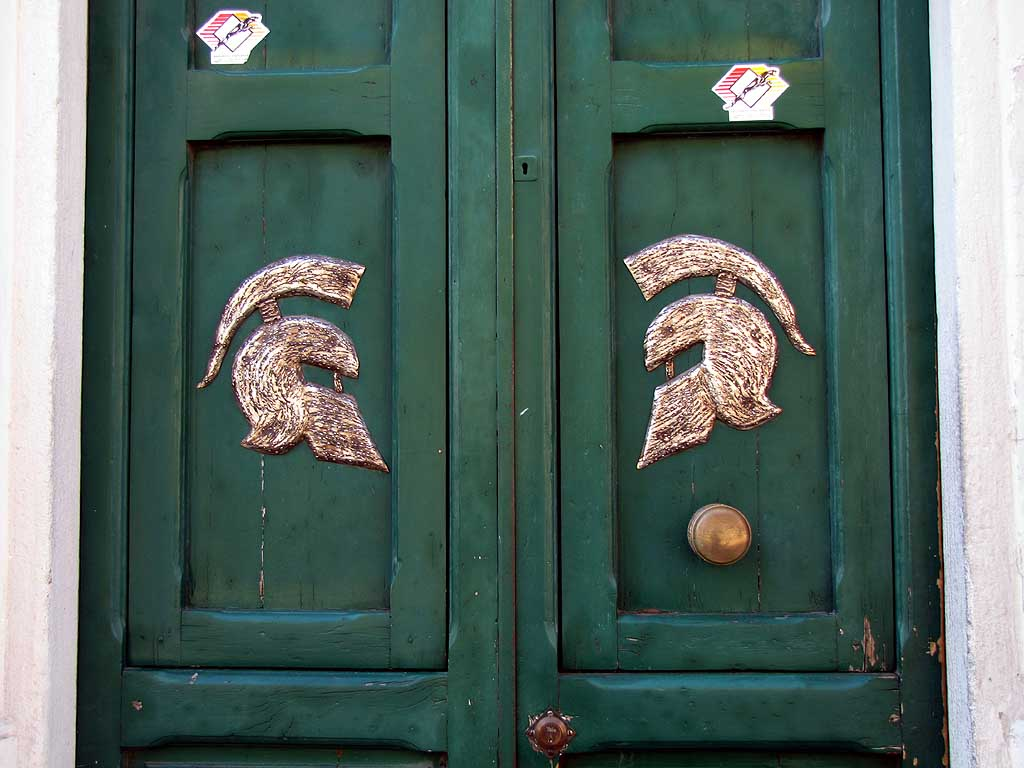 Greek helmets on a front door, Borgo dei Cappuccini, Livorno