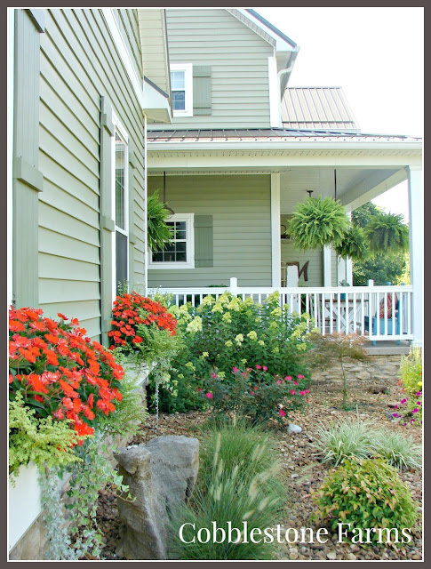 farm, farmhouse, farm tour, farmhouse tour, home tour, Cobbletstone Farms tour, flower beds, gardens, country porch, country, big porch, tin roof