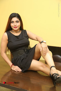 Tollywood Upcoming Actress Pooja Roshan Stills in Black Short Dress at Plus 1 Movie Trailer Launch  0175.JPG