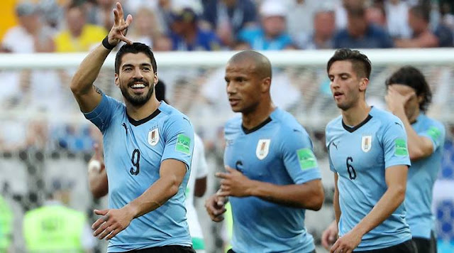 Barcelona striker Luis Suarez moved one goal behind Uruguay's record goalscorer at the World Cup, Oscar Miguez, with his seventh in total and his second in Russia this summer