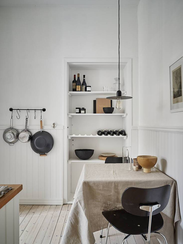 This thing will add an instant cozy vibe to your kitchen. Scandinavian kitchen design and linen tablecloth on the table. Photo via Stadshem