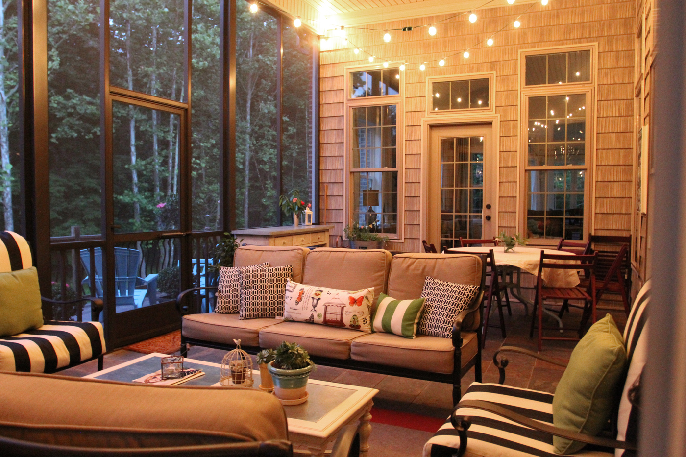 Screen porch with string lights  One day