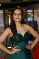 Raashi Khanna in Dark Green Sleeveless Strapless Deep neck Gown at 64th Jio Filmfare Awards South ~  Exclusive 112.JPG
